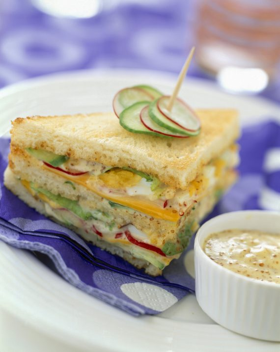 raw vegetable club sandwich with mustard