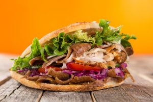 close up of kebab sandwich on wooden background #112712805